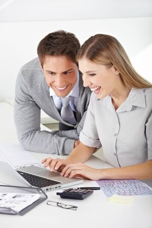 Happy man and woman Finding a job in the internet with laptop computer photo