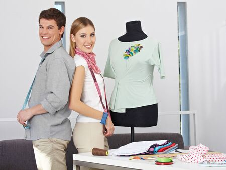 Two happy fashion designer standing with dress form in their studio Stock Photo - 15574696