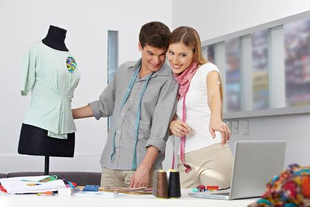 alteration shop: Man and woman studiyng fashion design as online class Stock Photo