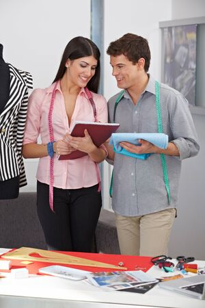 Young Fashion designer with smiling assistant in the studio Stock Photo - 15530001