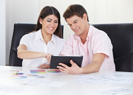 style advice: Happy couple doing color consultation with tablet computer and color samples