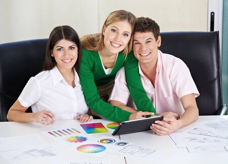 Art students with tablet computer learning color theory in the university Stock Photo - 15529995