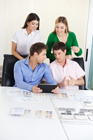 Group studying architecture in university with building materials on desk Stock Photo - 15529984