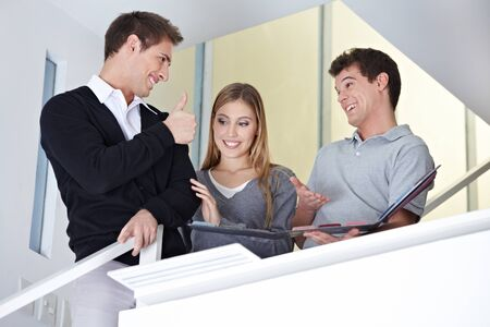 Man with woman at floorlayer office holding his thumbs up photo