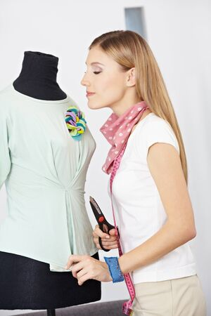 Female fashion designer working with a dress form in studio Stock Photo - 15611718