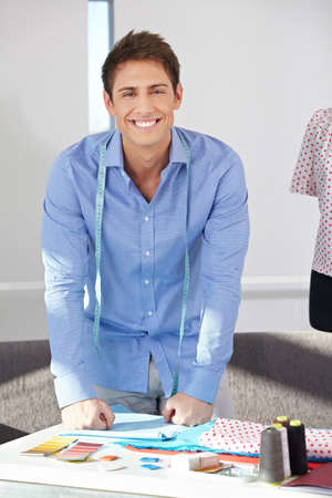Portrait of happy fashion designer standing in his office Stock Photo - 15611814