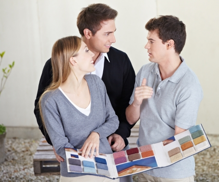 sellers: Couple looking at different carpet samples at floorlayer