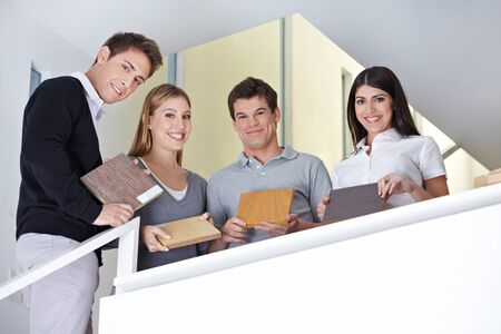 Happy sales team showing wood samples in office photo