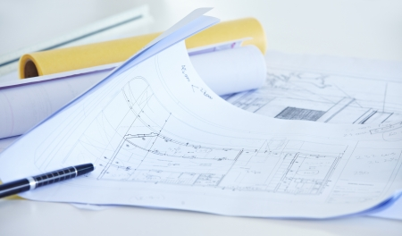 architectural studies: Different architectural drawings with pen on desk in office Stock Photo