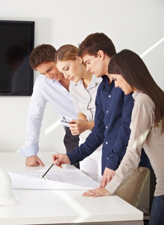 architectural firm: Architects team working on construction drawing in their office