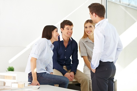architectural firm: Happy young team having a meeting in the office Stock Photo