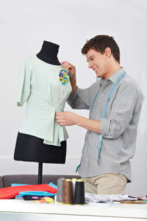 Happy tailor working on dress form in his studio Stock Photo - 15679645