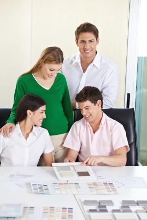 Architectural students with different building materials at a desk Stock Photo - 15679648