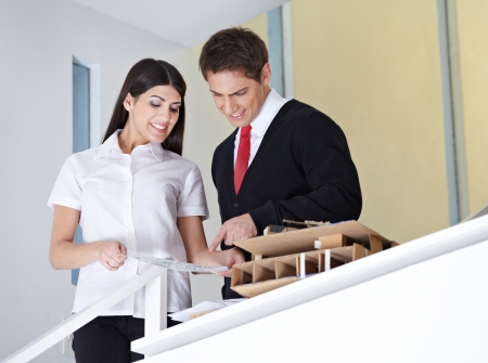 Two architects in the office discussing a construction drawing photo