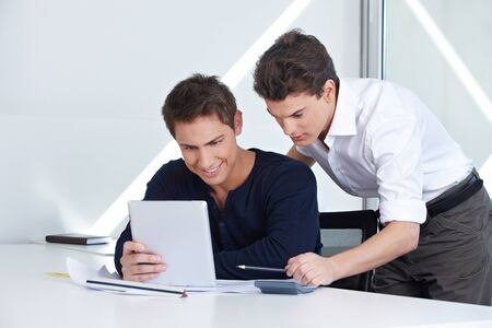 Architects in their office looking at a tablet computer Stock Photo - 15679641