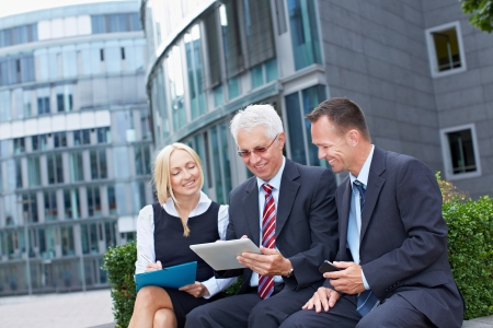 scheduling: Modern business team working outside the office with tablet PC