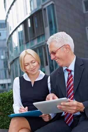 Two business planning with tablet computer and files Stock Photo - 15784013