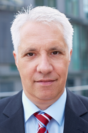 Senior business man with blank expression on his face Stock Photo - 15784004