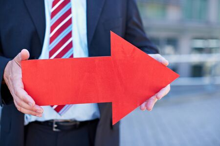 career fair: Business man with red arrow pointing to the right Stock Photo