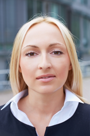 Portrait of a blonde business woman with blank expression photo