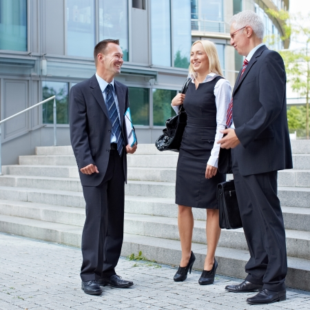 Group of happy business people talking outside photo