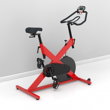 hometrainer: Red spinning bike at home in the training room