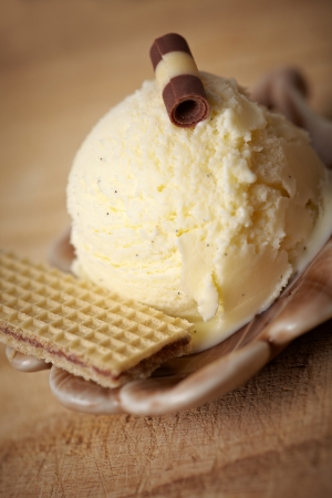 Homemade vanilla ice cream with waffle and decoration in a bowl photo