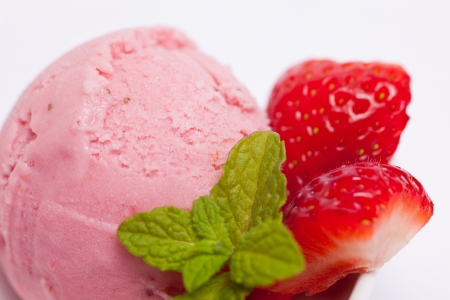 Fresh homemade strawberry ice cream with sliced strawberries photo