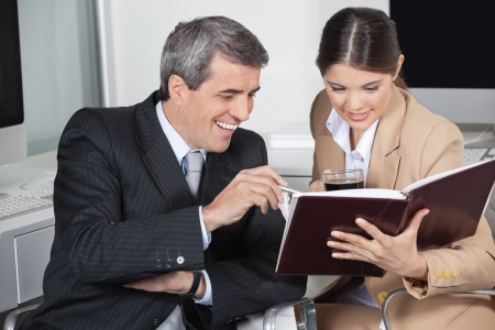 Two happy business people with a full order book in the office Stock Photo - 16128660