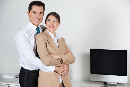 Business love affair in the office with a manager and a secretary Stock Photo - 16128603