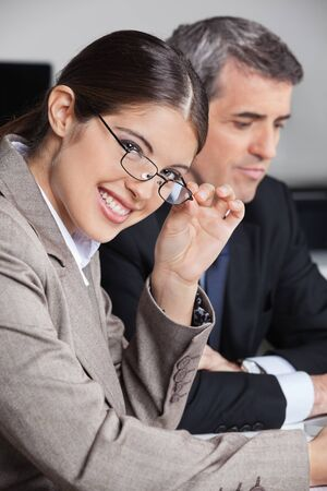 Attractive businesswoman with glasses in a business meeting in the office Stock Photo - 16128658