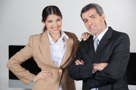 Two happy businesspeople together in the office Stock Photo - 16166196
