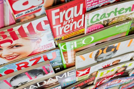 Many different colorful magazines in a shelf for sale in Germany Stock Photo - 16284383
