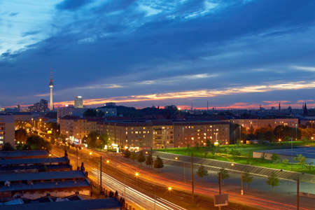 property berlin: Berlin with TV tower at dusk with many lights and clouds Stock Photo