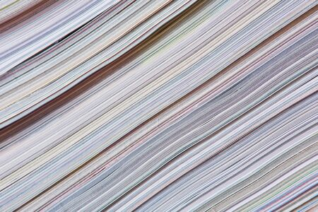 Abstract newspaper background made from a stock of magazines photo