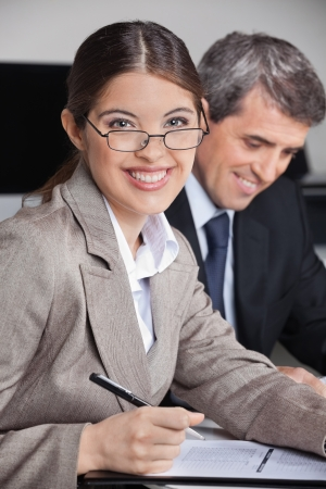 Successful business woman with glasses in the office looking into the camera Stock Photo - 16253767