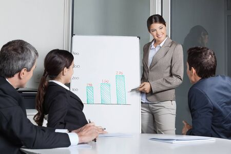 Business people listening to presentation with a whiteboard in the office Stock Photo - 16253753