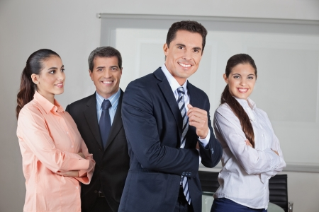 Portrait of smiling business office team with the arms crossed photo