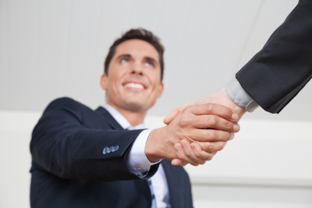 Two business manager shaking hands in the office photo