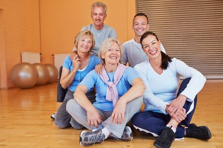 Portrait of happy smiling senior group in a health club photo