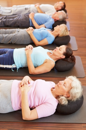 Group of seniors doing relaxation exercise in gym Stock Photo - 16405483