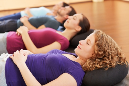 yoga meditation: Young group relaxing together in a fitness center Stock Photo