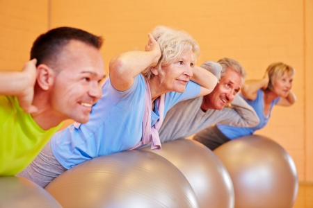 active seniors: Senior group in back training class exercising in fitness center Stock Photo
