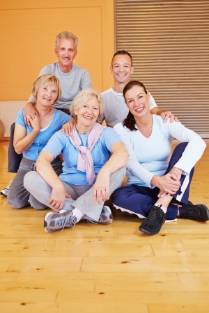 Portrait of happy senior people group sitting in a gym Stock Photo - 16502530