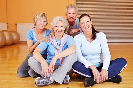 citizen: Happy group of senior citizens sitting in a fitness center gym Stock Photo