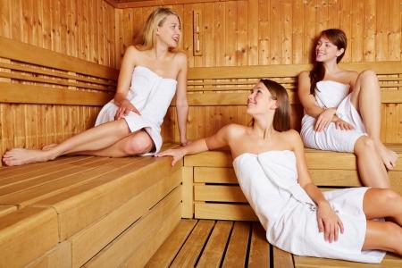 sauna: Three attractive women in sauna relaxing and talking