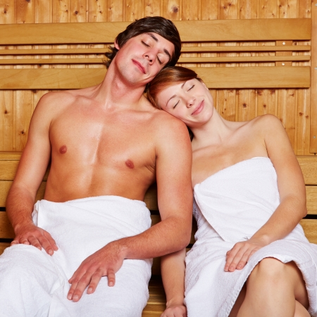 Relaxed couple in sitting tired in a sauna photo