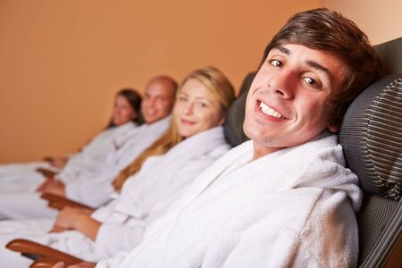 Relaxed couples smiling after the sauna in a hotel Stock Photo - 16490268