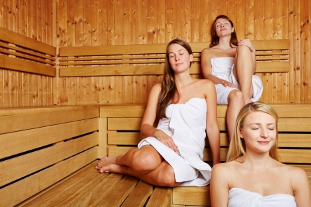 Women's health: Three women relaxing with eyes closed in a ladys sauna Stock Photo