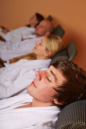 Two couples resting in relaxation room after the sauna photo